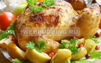 Курица с яблоками в духовке целиком